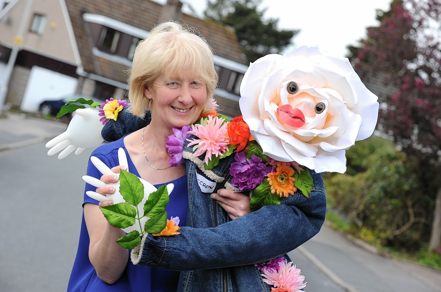 Ann Westwood with scarecrows she has made for a scarecrow trail set up in Westhill