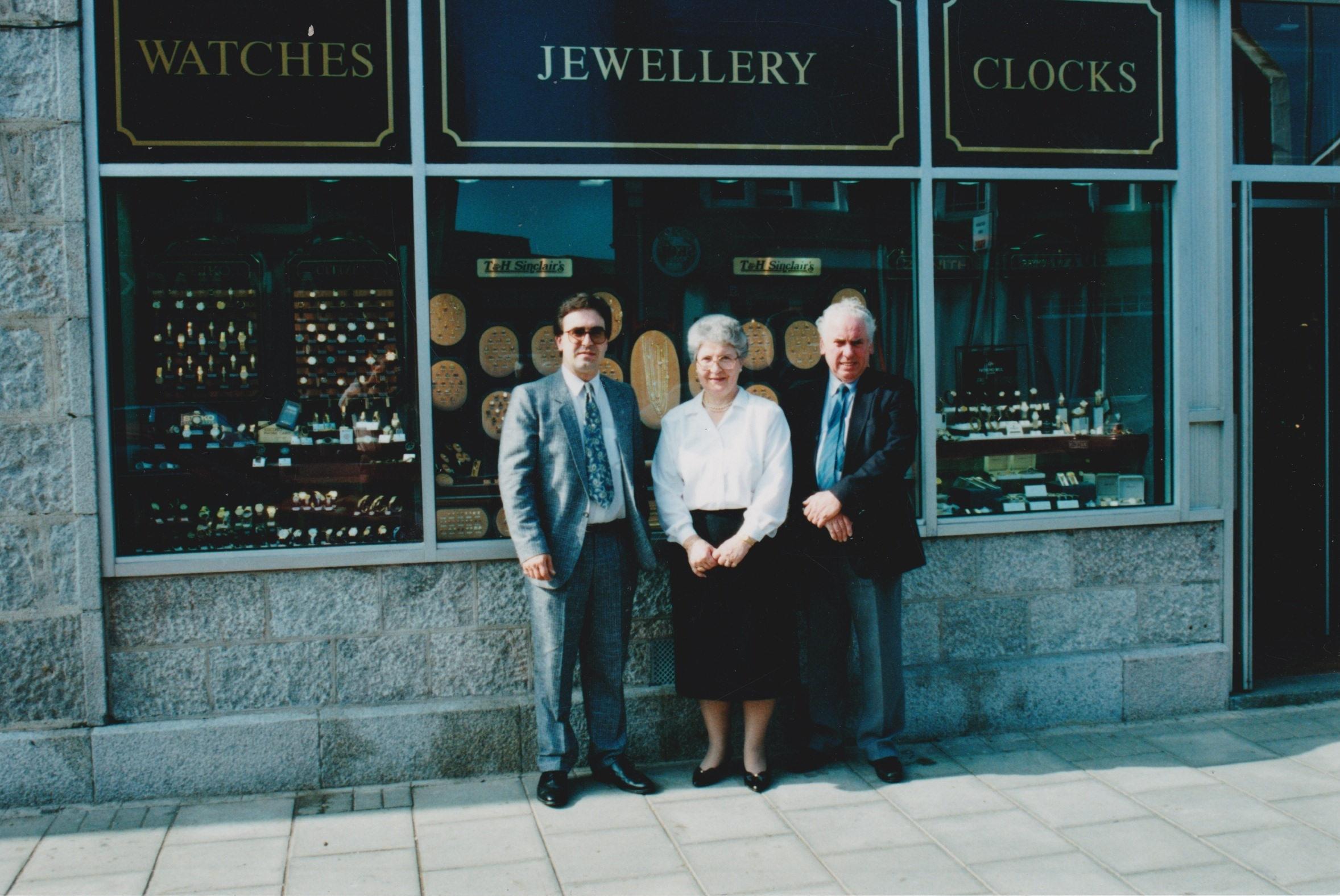 Ian Sinclair with his parents Helen and Tom outside the shop