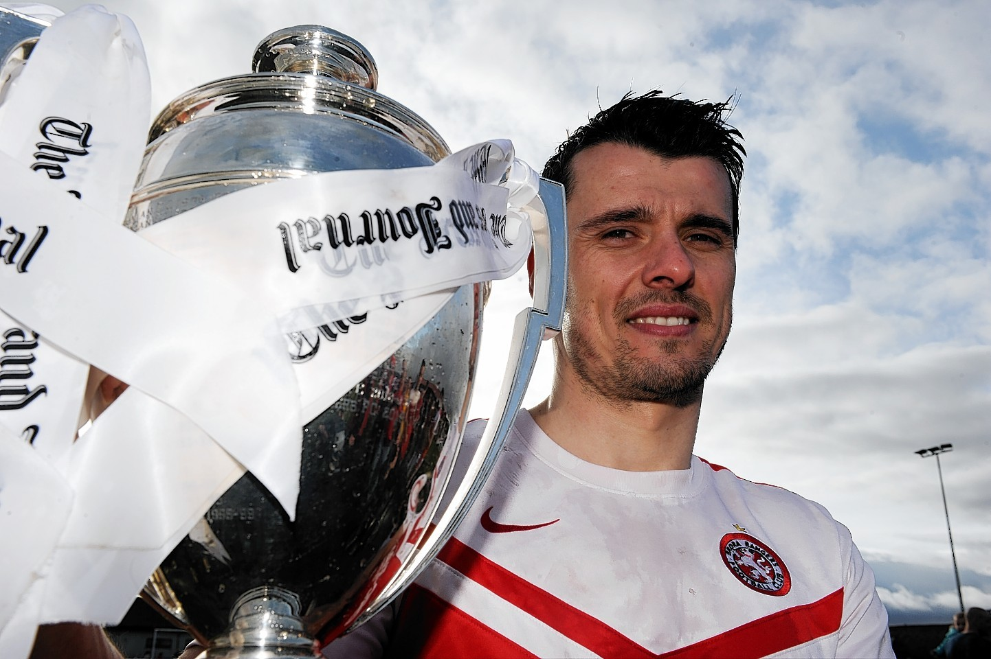Steven Mackay celebrates with the Highland League trophy