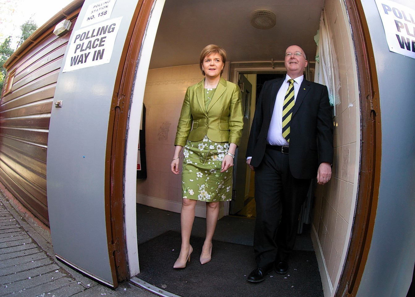 Nicola Sturgeon casts vote at Broomhouse Community Hall in Baillieston with her husband Peter Murrell.
