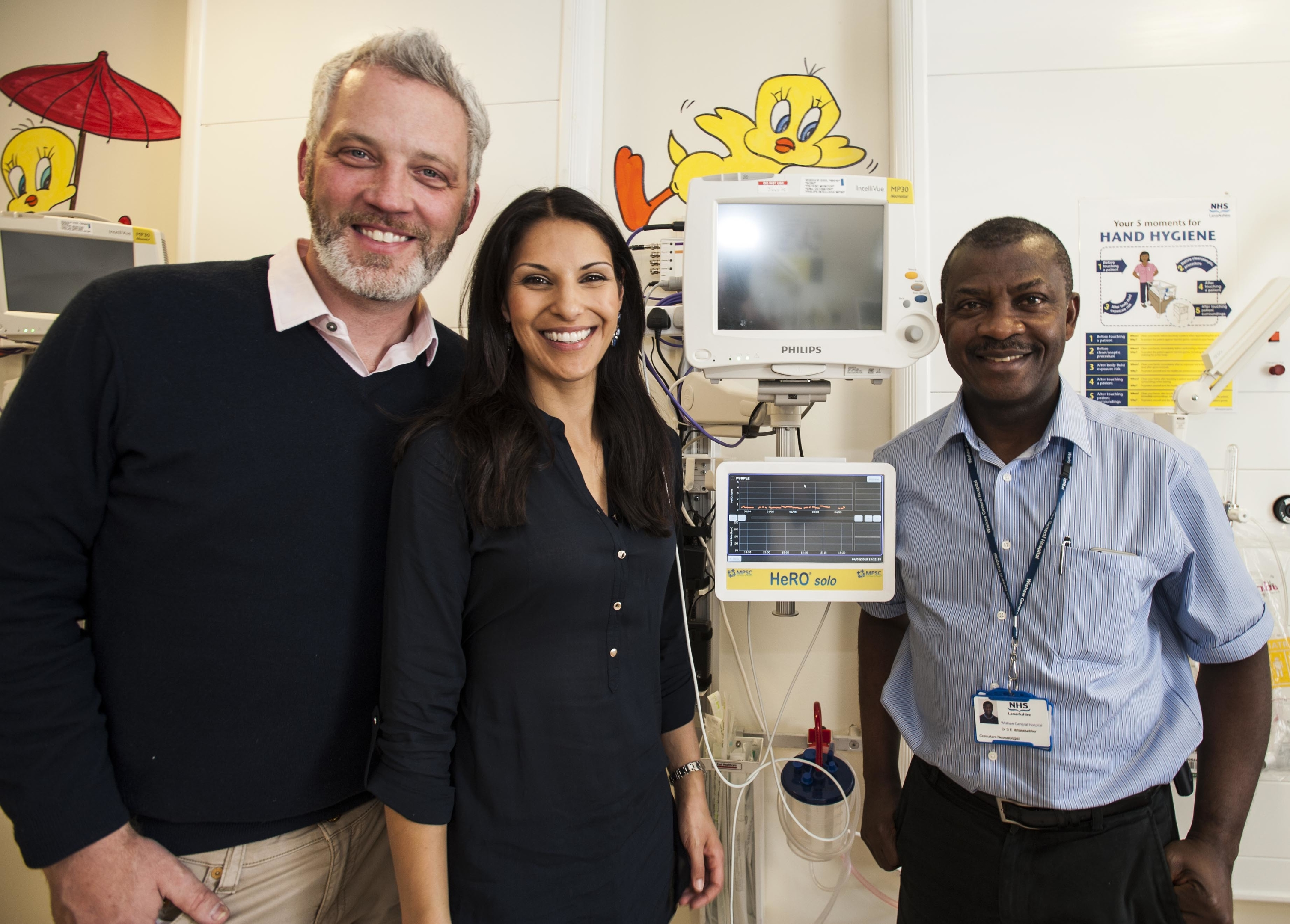The couple with a donated HeRO monitor at Wishaw General Hospital's neonatal unit