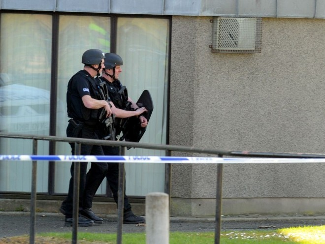 Police search the Kincorth Land flats last month.