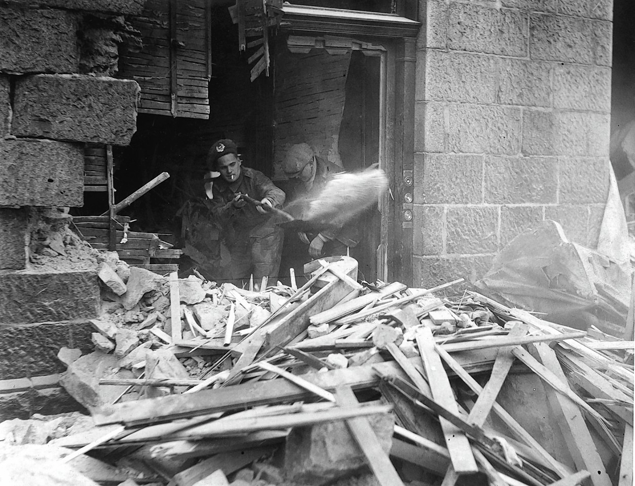 Clearing up after an air raid at Bedford Road, Aberdeen in April 1943.