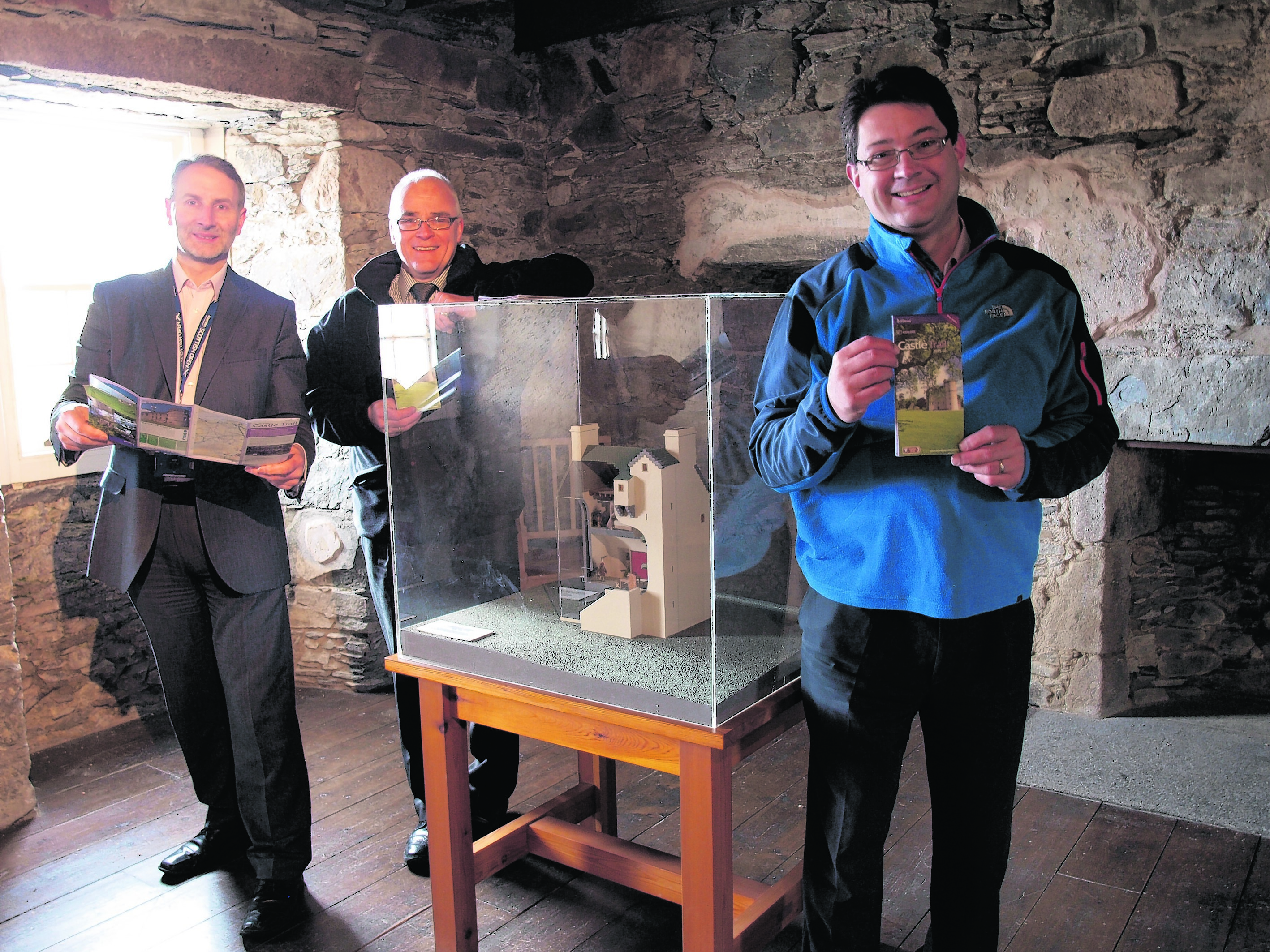 From left: David Wright, VisitScotland, George Wilson, Historic Scotland, and Philip Smith, VisitScotland,  show off the new guides at Corgarff Castle