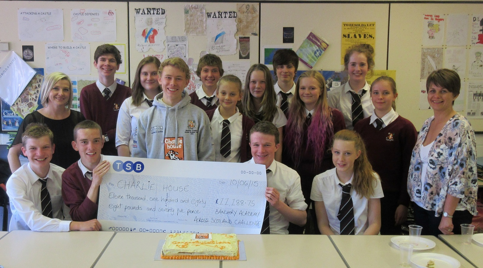 Banchory Academy pupils holding the cheque which they handed over to Charlie House following the Across Scotland challenge