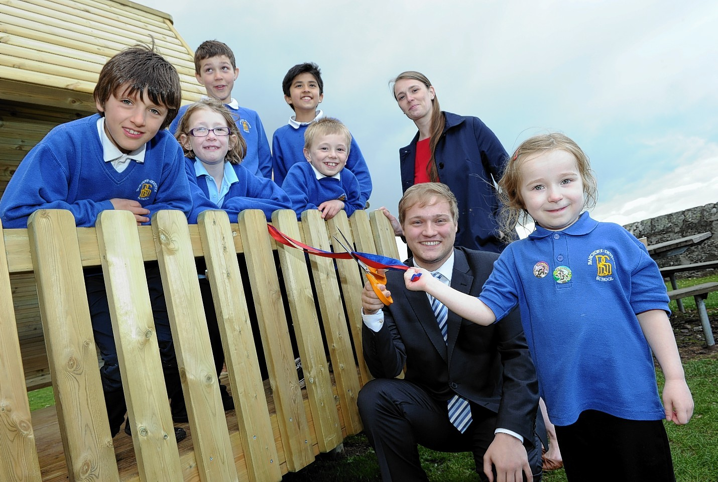 Pupils look on as head teacher Michelle Watson, Stuart Donaldson MP and pupil Lauren Nicolson, cut a ribbon to open their new finished playground