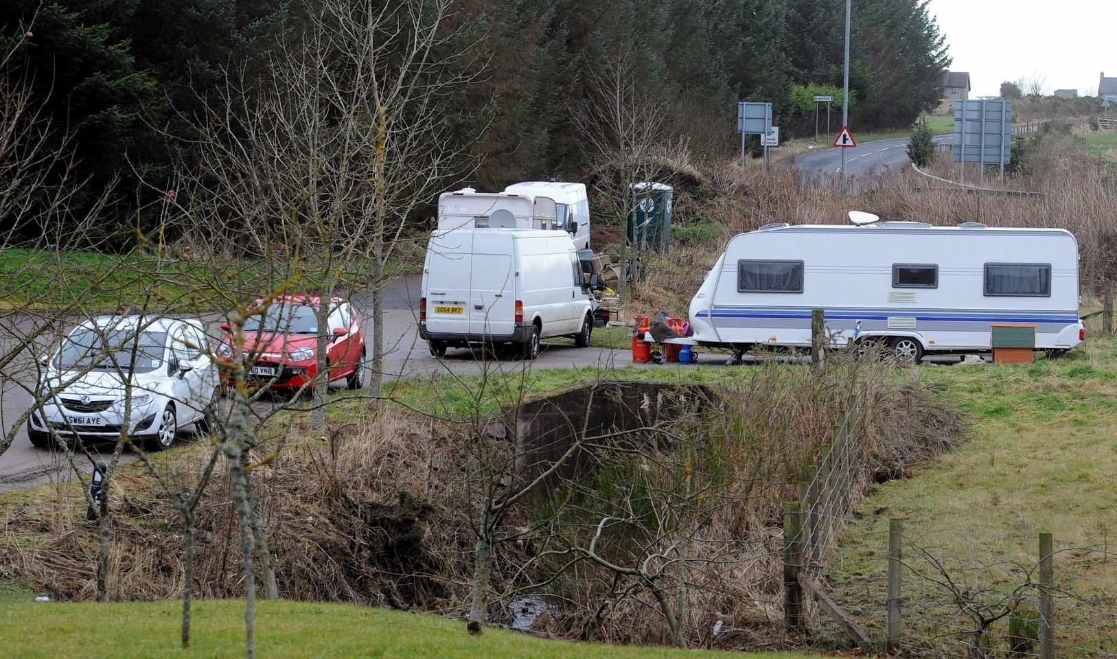Travellers off Golf Road Ellon, at it's junction with the A948 in 2013