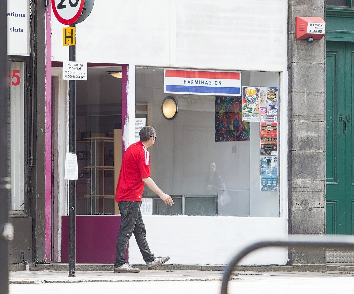 The owners of Harminasion, the first shop in Scotland to be closed down by police for selling legal highs, have opened up a new store next to a police station in King Street in Aberdeen