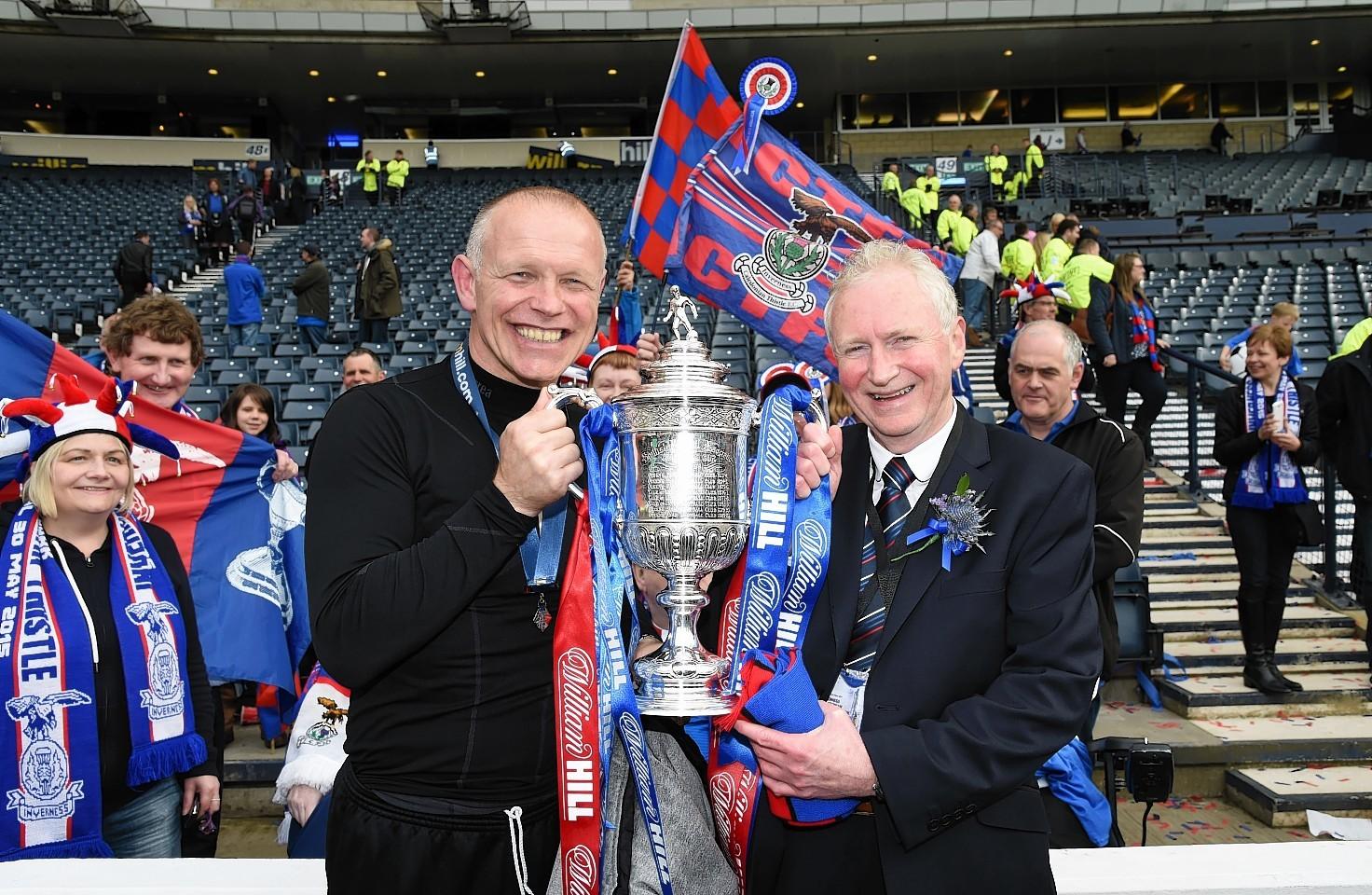 John Hughes and Kenny Cameron hold aloft the Scottish Cup just last May