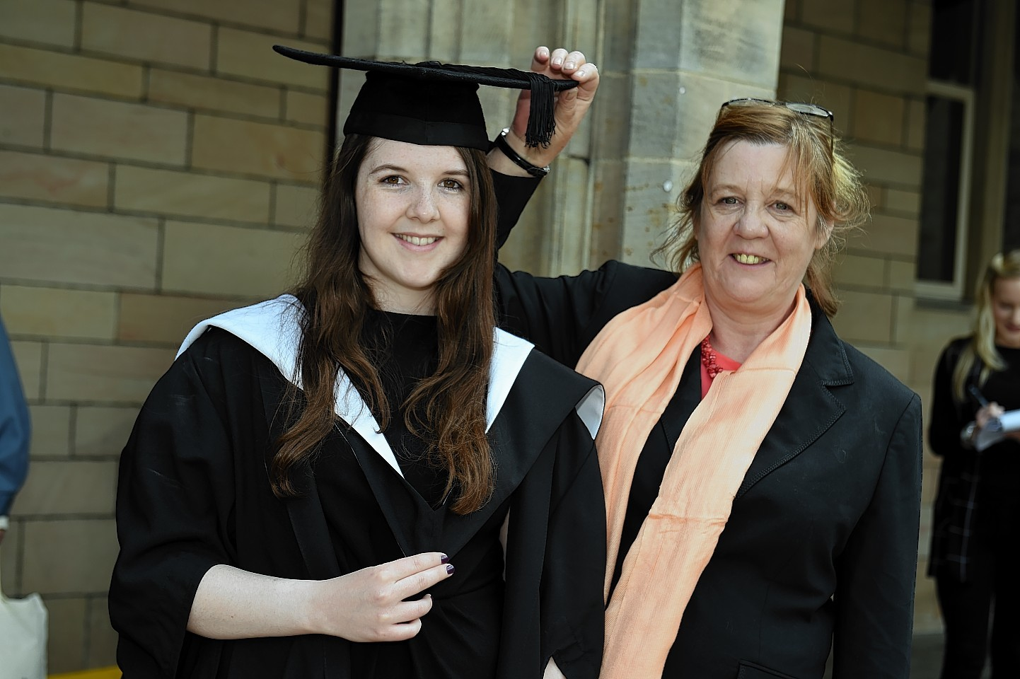 Lily Scanlon celebrates graduating at Elphinstone Hall with mother  Jacqui. Picture by Kenny Elrick
