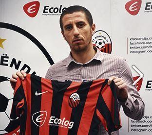 Shkëndija play in a red and black AC Milan style strip