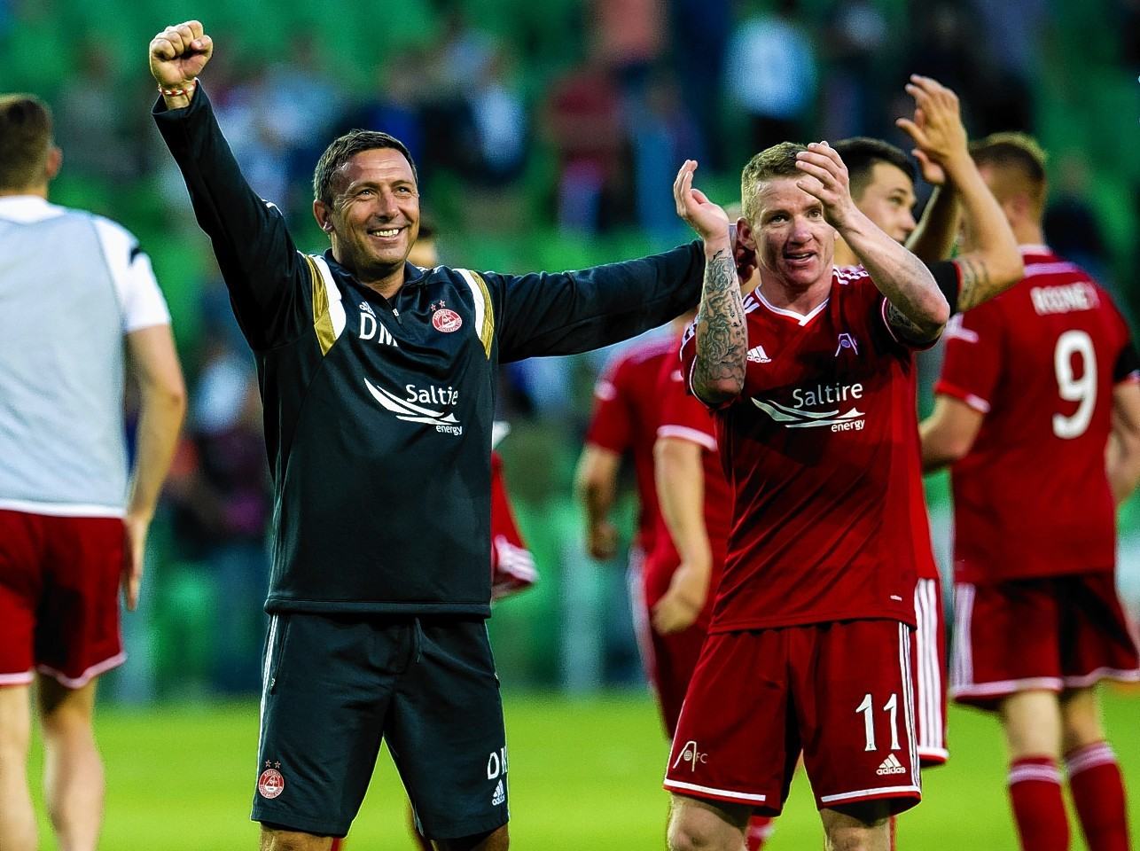 McInnes celebrates guiding the Dons to European success over Groningen last season
