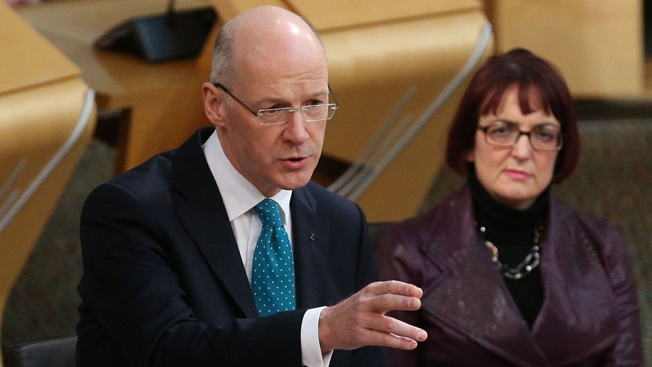 Parliament backed Deputy First Minister John Swinney's motion