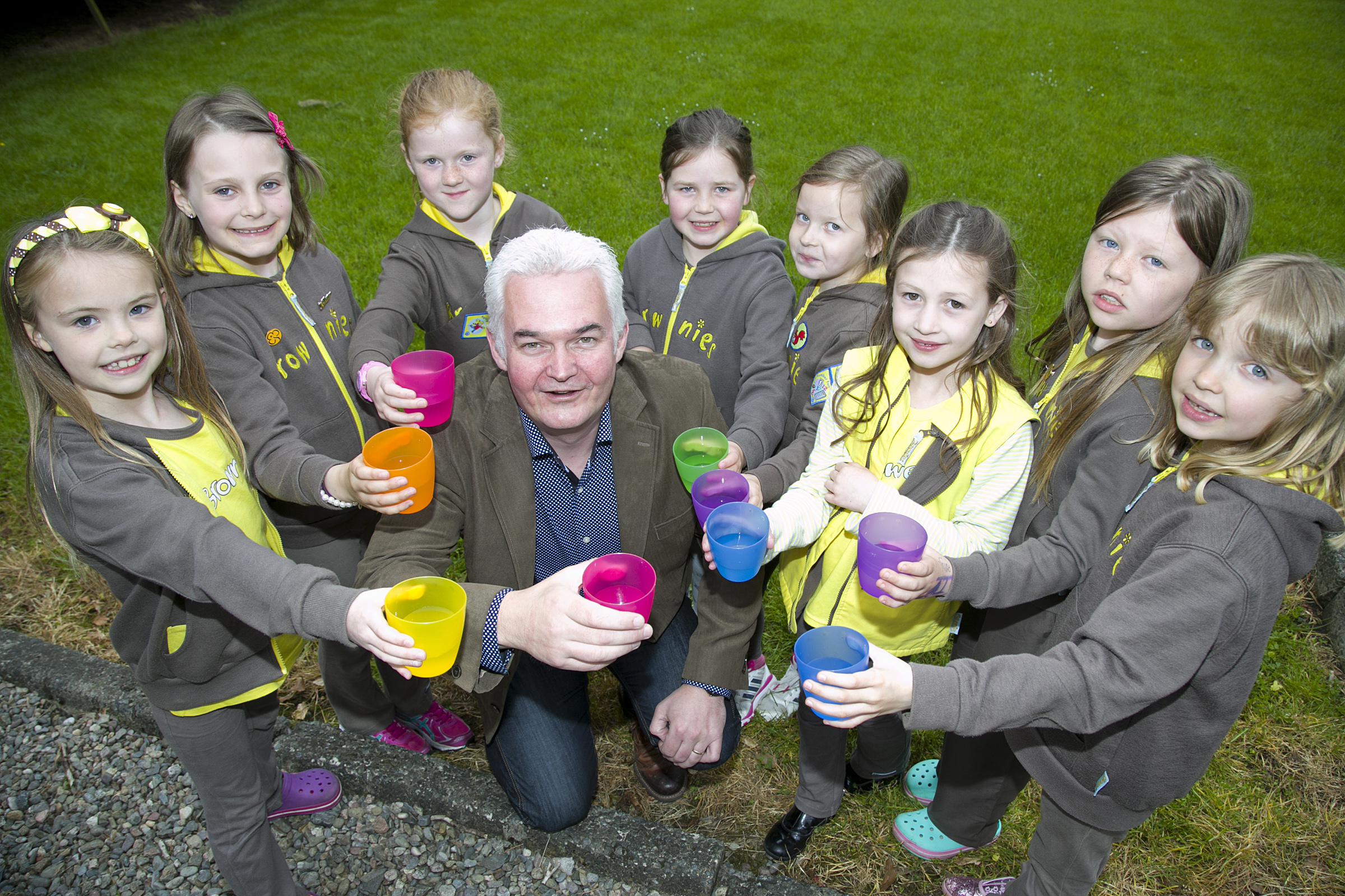 Guides and Brownies in Ellon benefited from last year's Ythan Challenge. Helping them celebrate was Paul McAlister of CETCO.