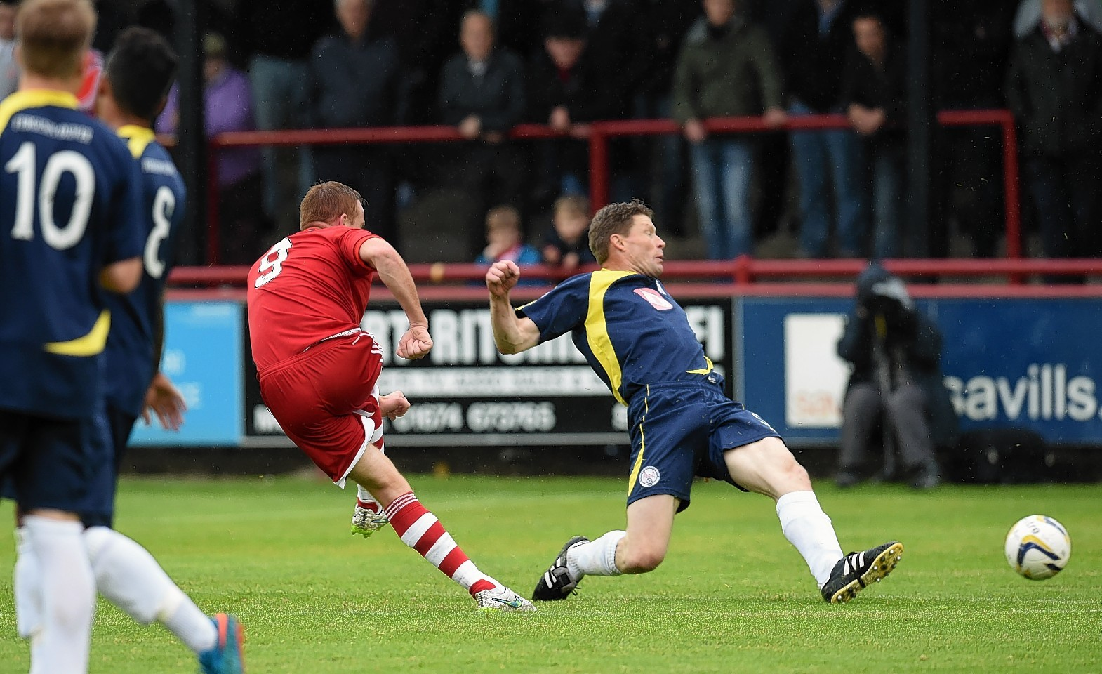 Adam Rooney fires home  the Dons' second goal