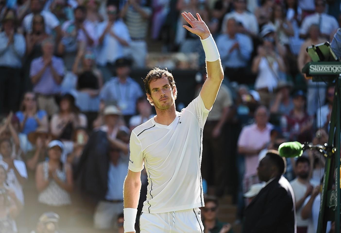 Andy Murray salutes the fans at Wimbledon as he defeats Mikhail Kukushkin