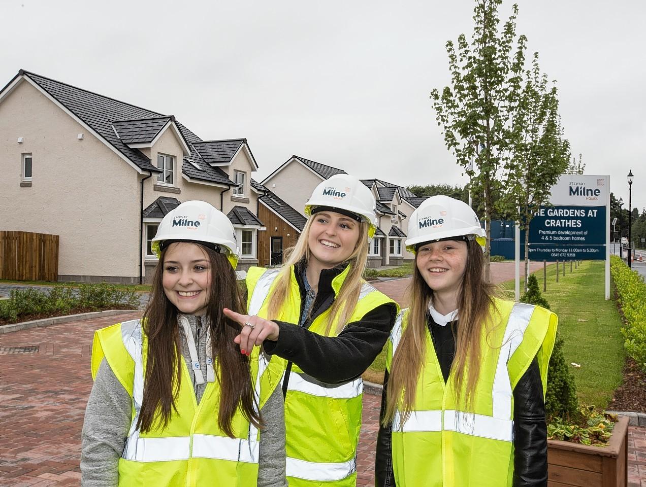 Apprentice quantity surveyor Abbie Duthie (centre) with pupils Natalia Lisowska (left) and Chloe Kelly (right)