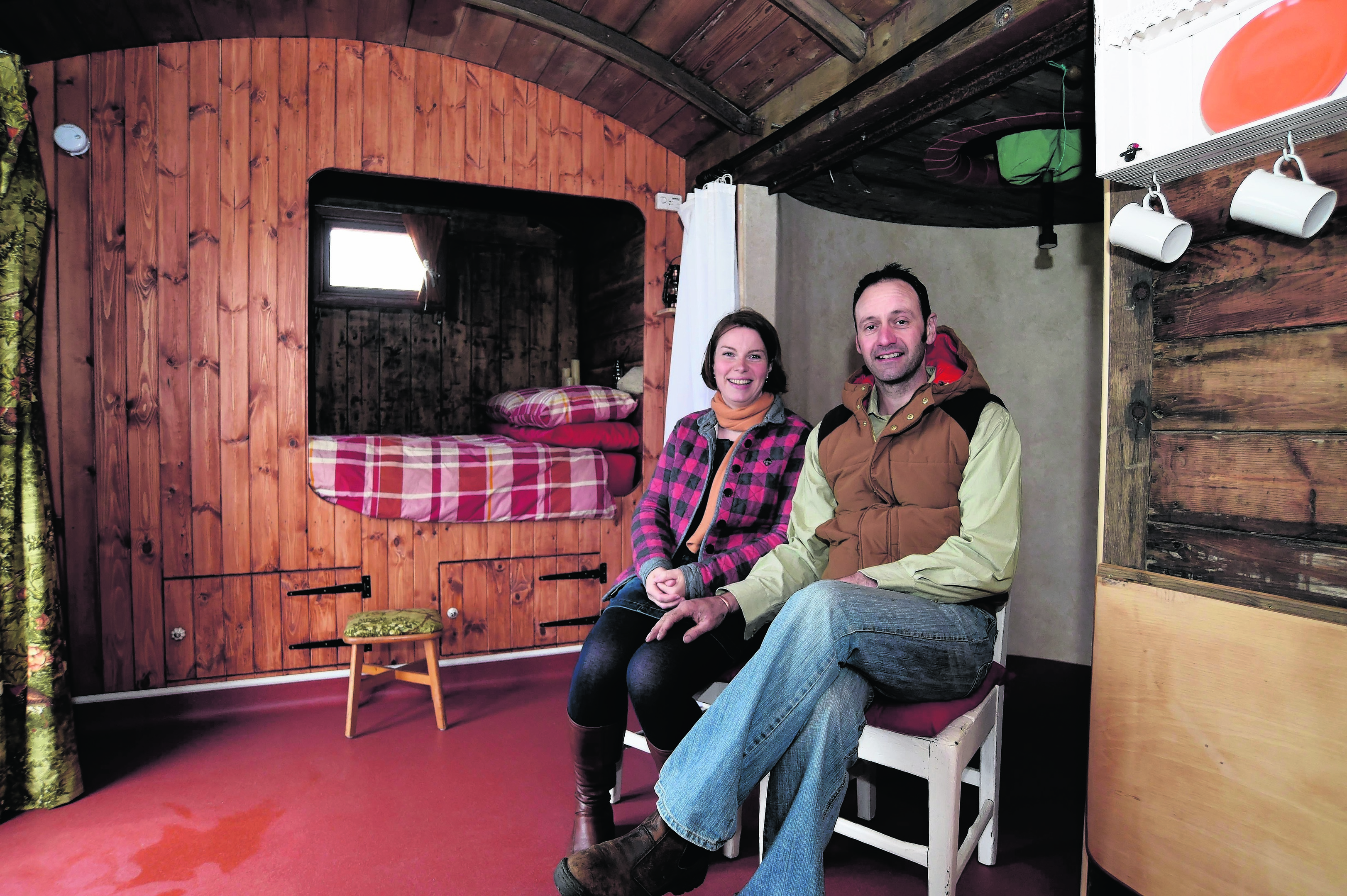 MATTHEW AND CAROLE SHORT IN THE 1930'S FREIGHT TRAIN CARRIAGE THEY CONVERTED TO A HOLIDAY HOME AT HIGH SEAS HOBBITS, ROSEHEARTY.