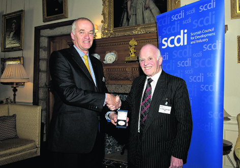 Colin Parker receiving his SCDI Fellowship Medal from Jim Milne