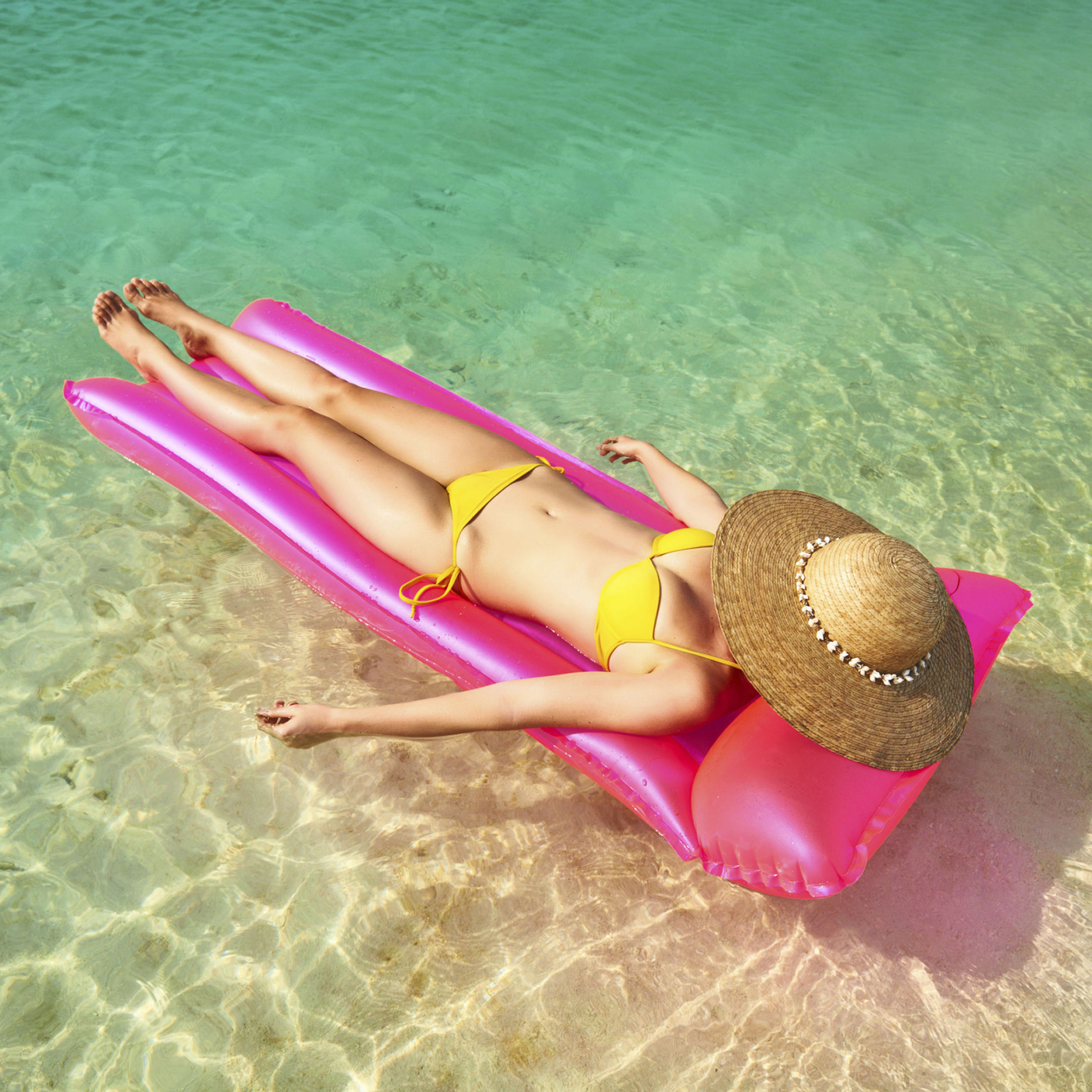 A Generic Photo of a woman relaxing in her bikini, in the sea. See PA Feature TOPICAL Weight Gain. Picture credit should read: PA Photo/thinkstockphotos. WARNING: This picture must only be used to accompany PA Feature TOPICAL Weight Gain.