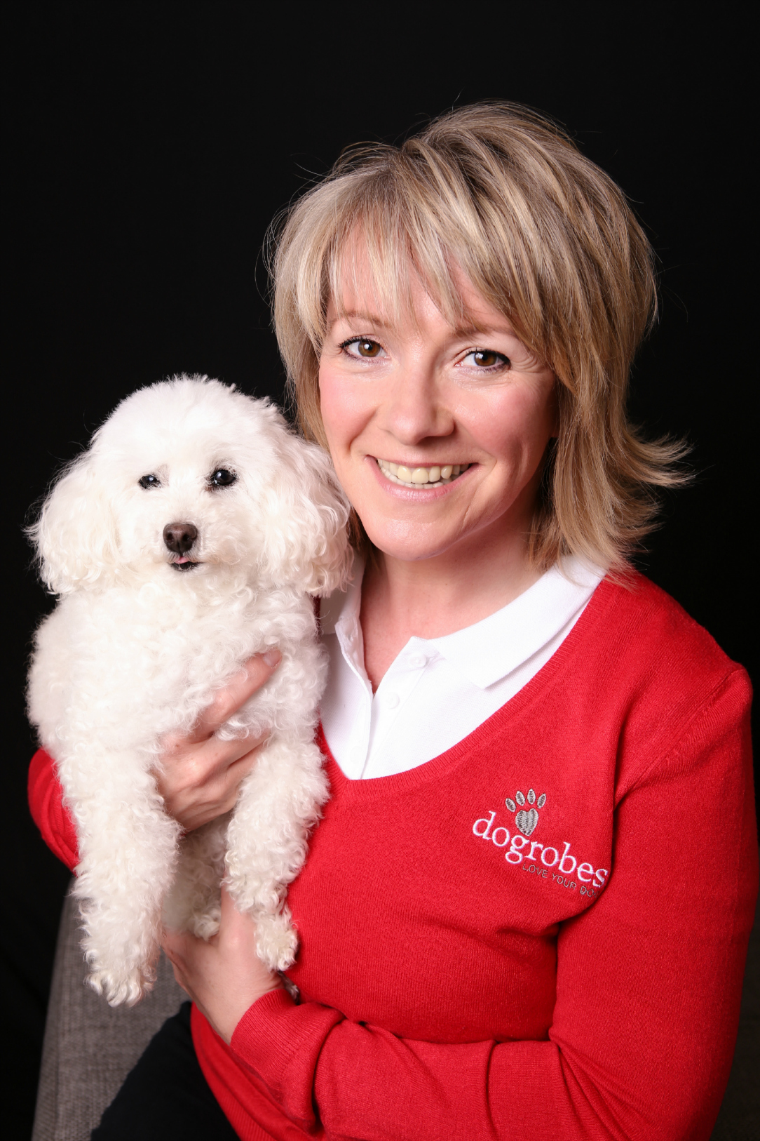 Dogrobes owner Margaret Reynolds with poodle Missy