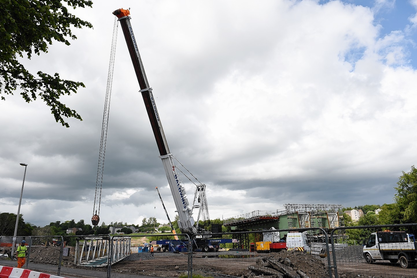 The big crane which will be used to manoeuvre the steel beams into place over the River Don, is being put together on site at the Third Don Crossing.