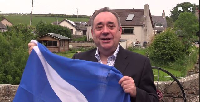 Alex Salmond holding the saltire flag