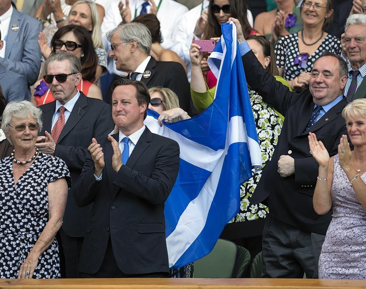 Alex Salmond raises the Saltire following Murray's win in the Wimbledon final