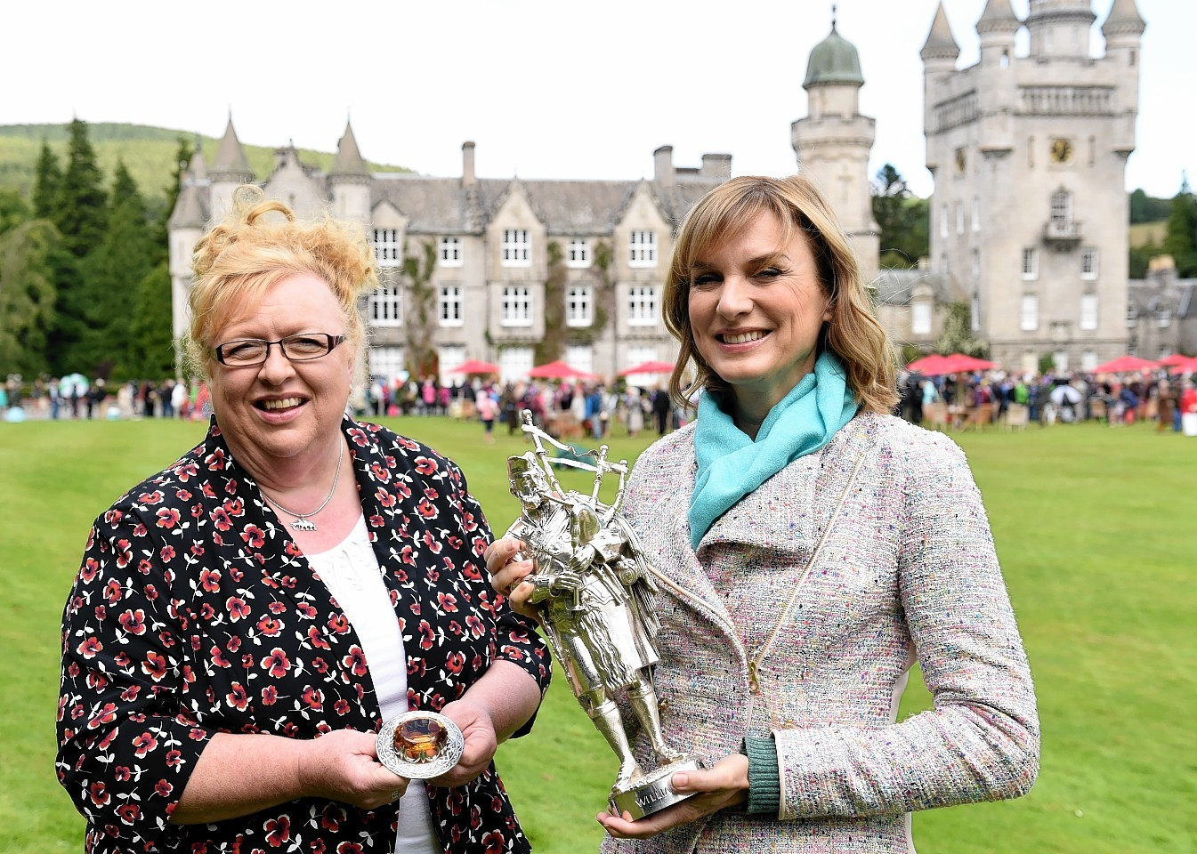 Balmoral housekeeper Sheena Stuart and presenter Fiona Bruce with Prince Albert brooch and William Ross statue. Picture by Kami Thomson