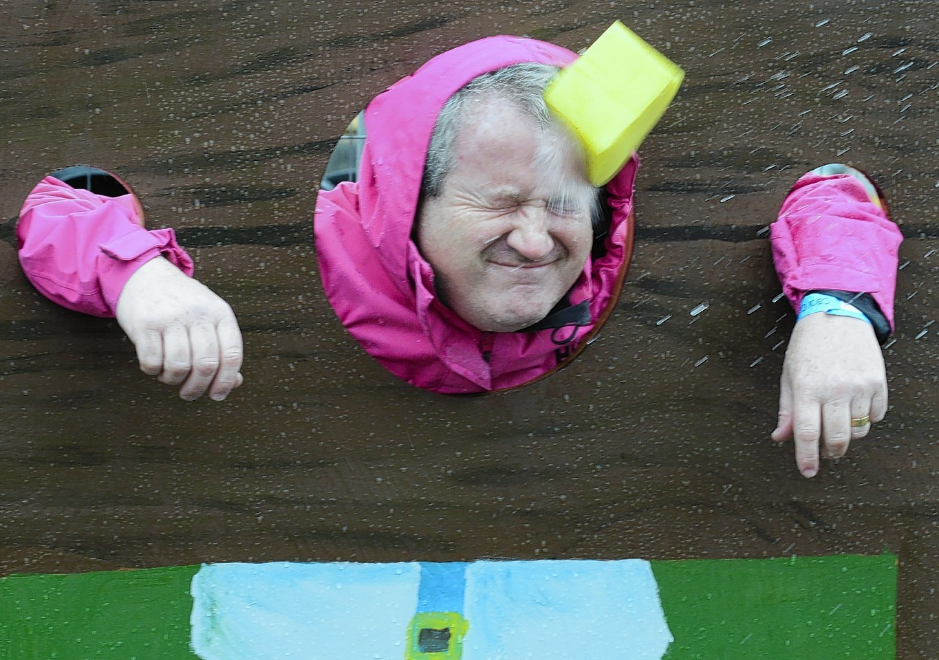 Ross, Skye and Lochaber MP Ian Blackford takes a turn being 'sponged' in the stocks to raise money for future Caol Gala days.