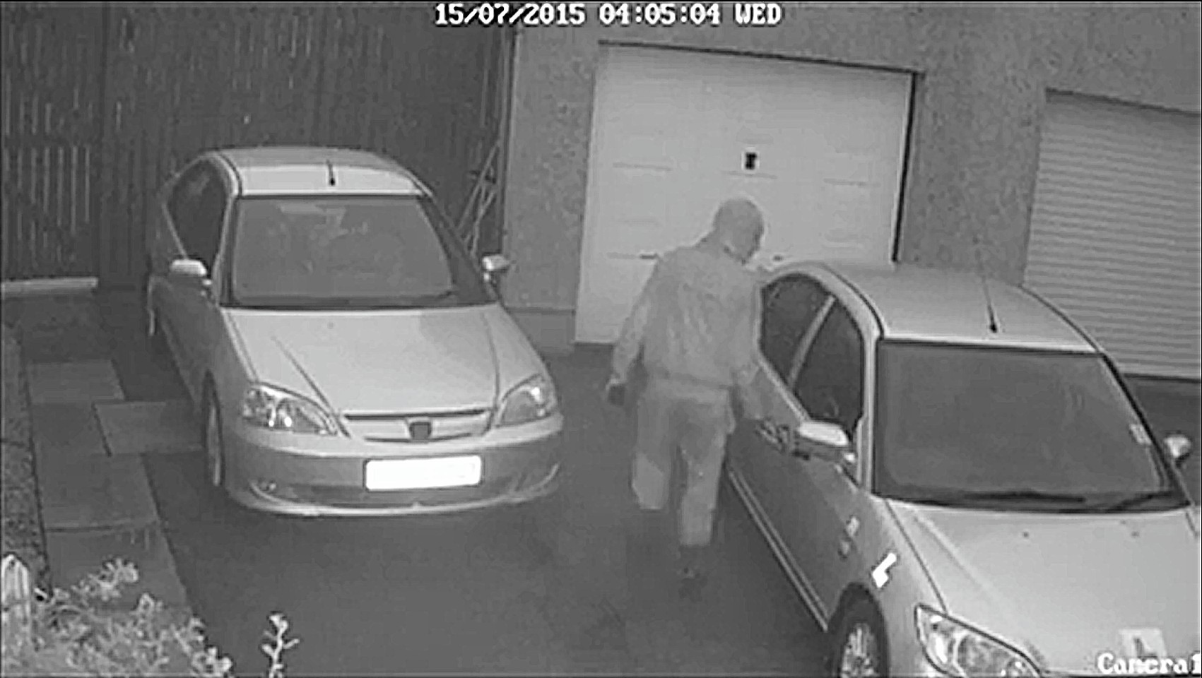 CCTV screen grabs of two prowlers trying the doors of cars in the Elrick area of Westhill.