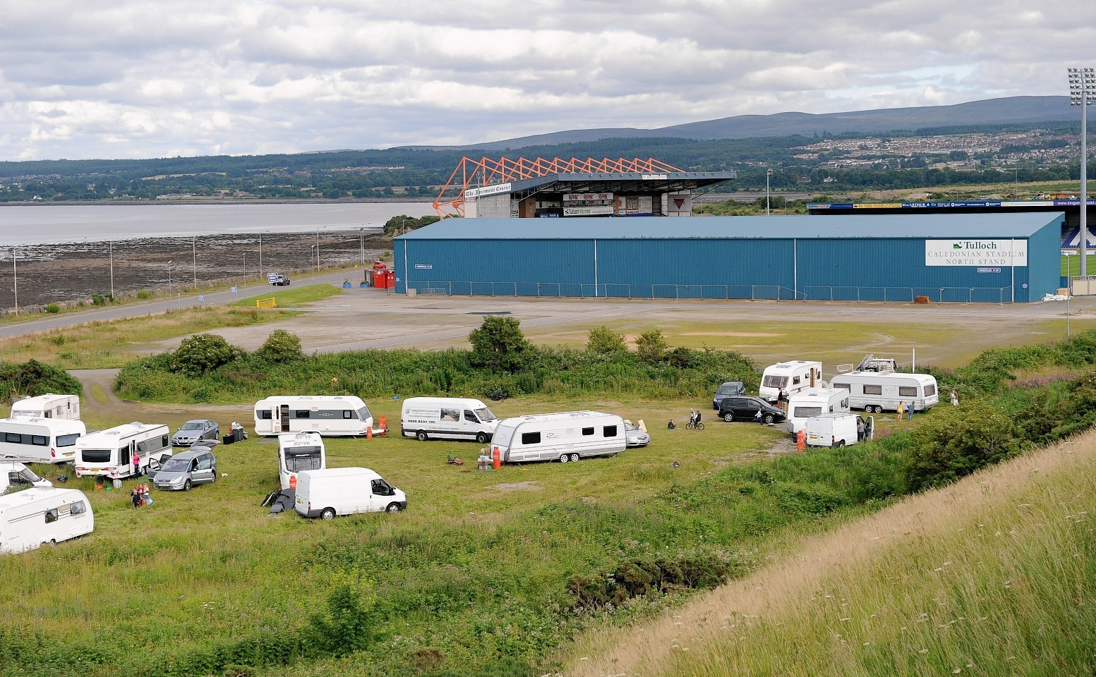 Travellers have made camp in the car park of the Caley Stadium in Inverness.