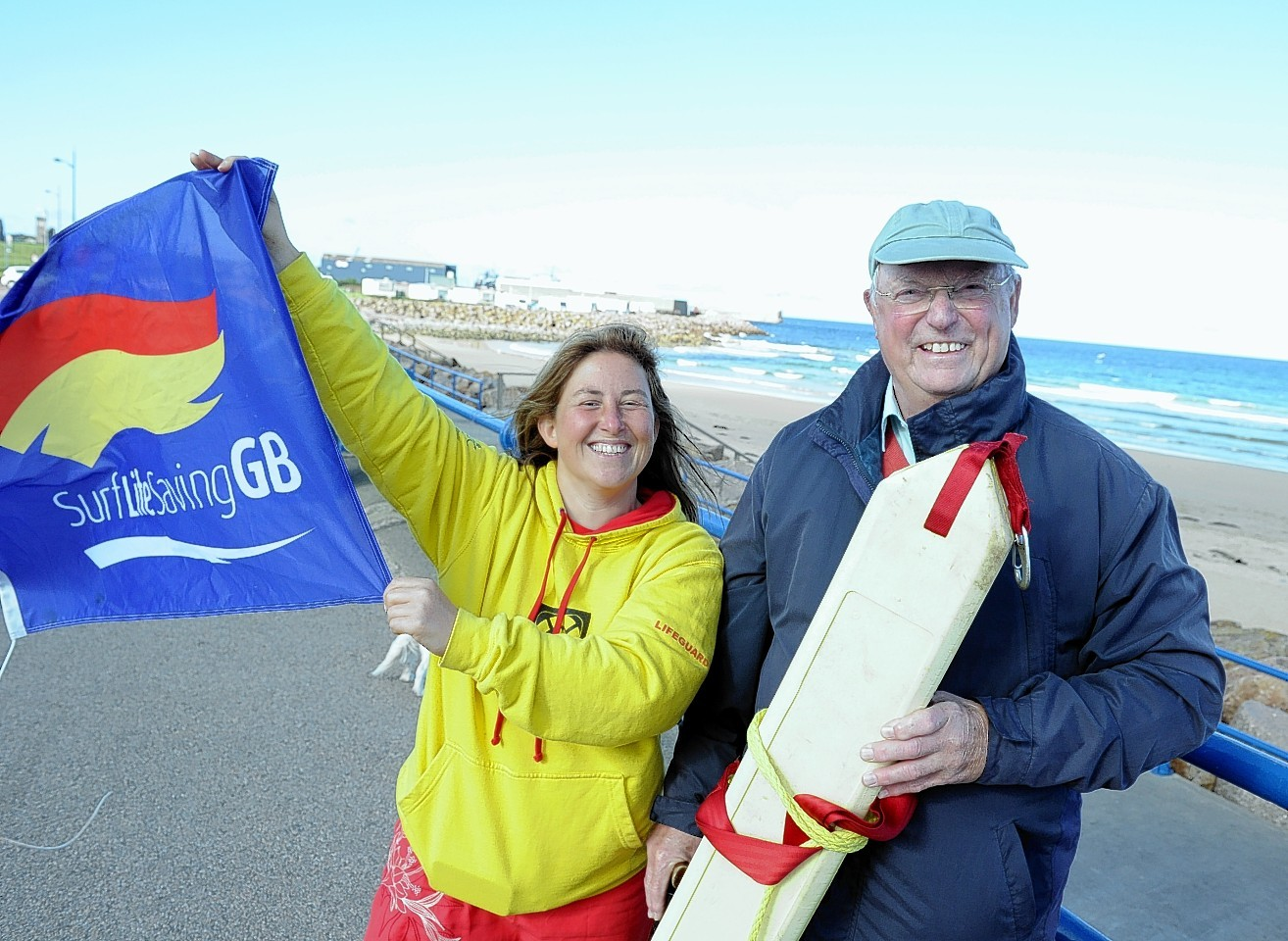 Councillor, Ian Tait and surf instuctor, Claire Levett at the Kessock  beach, Fraserburgh. Picture by Jim Irvine