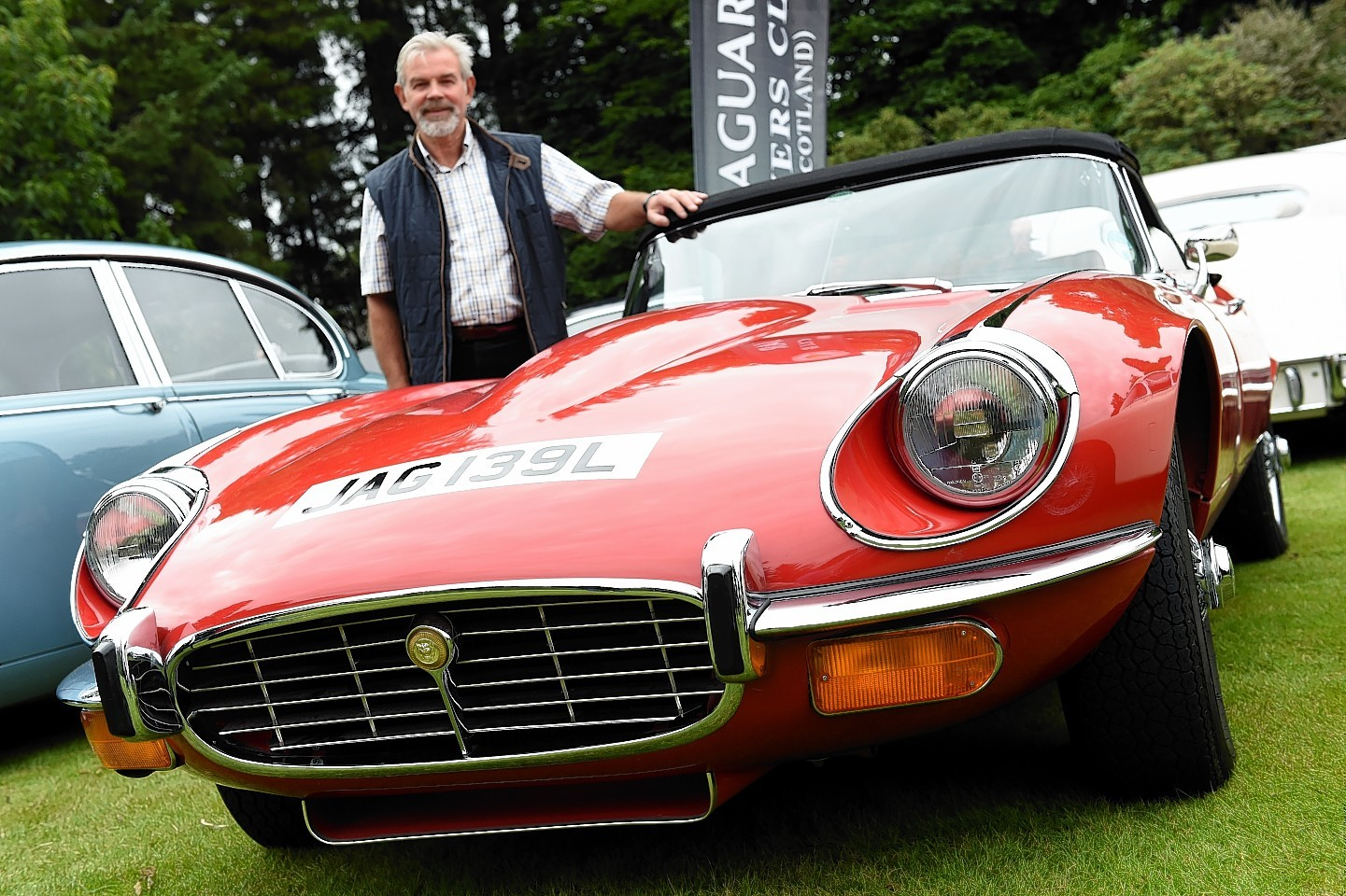 The Jaguar Enthusiasts Club, Grampian Region, Annual Gathering at Drum Castle, Drumoak, Aberdeenshire.      Pictured - Tom Taylor with his Jaguar series 3 E-type V12. Picture by Kami Thomson