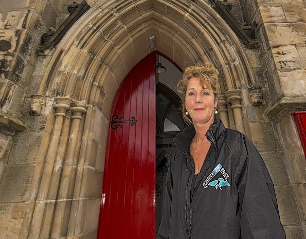 Owner Jo Maunder at the front door of the church