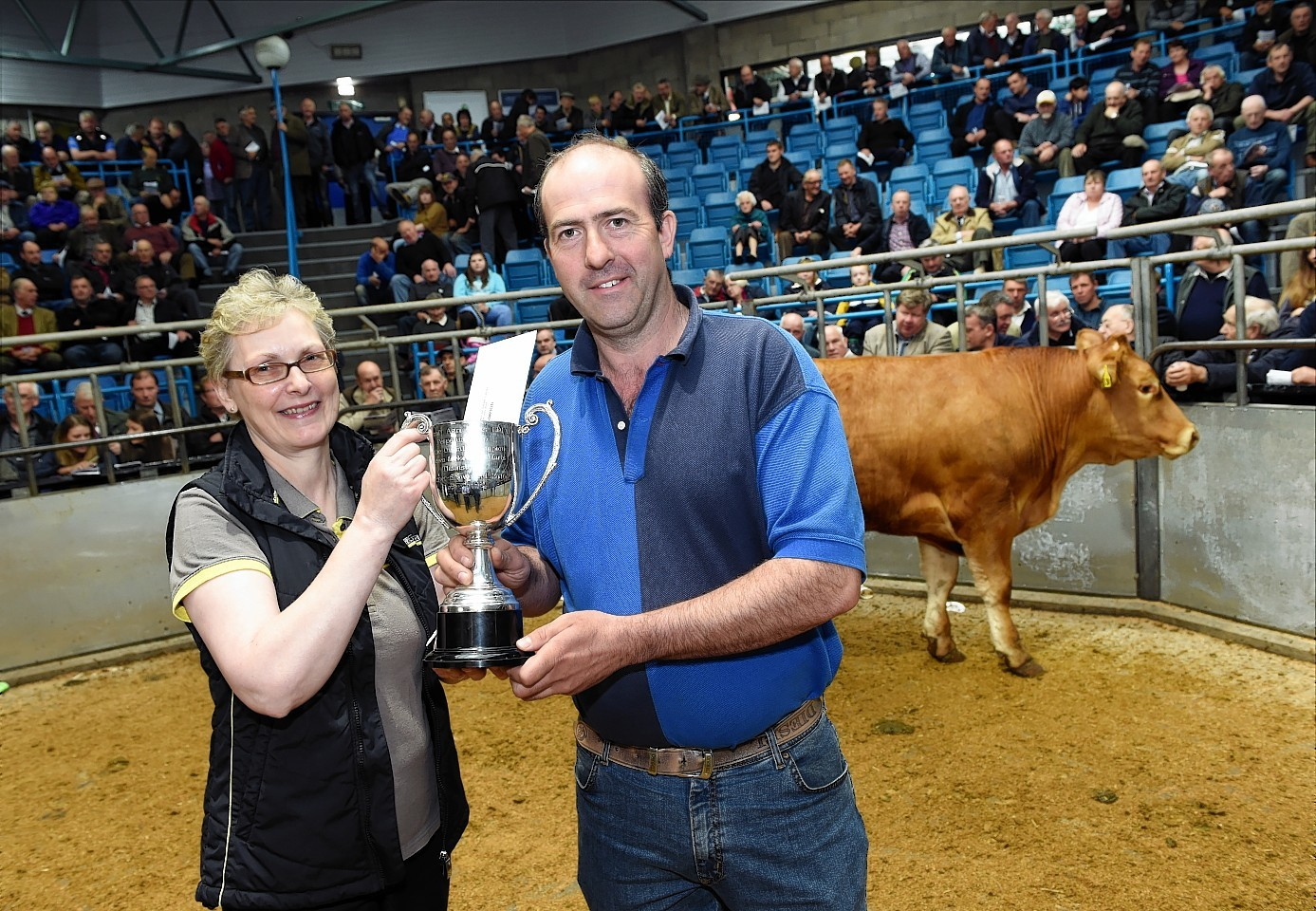 Gavin Greenlaw was presented with his trophy by Eileen Brown from show sponsor Turriff Agri Parts