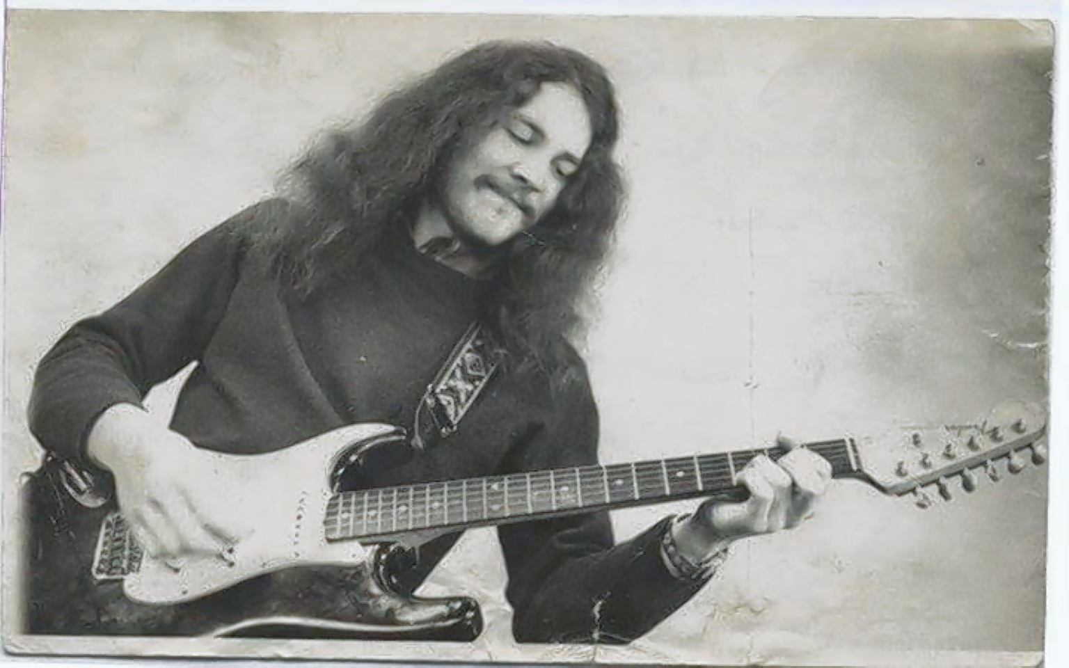 Graham Oliver with his guitar