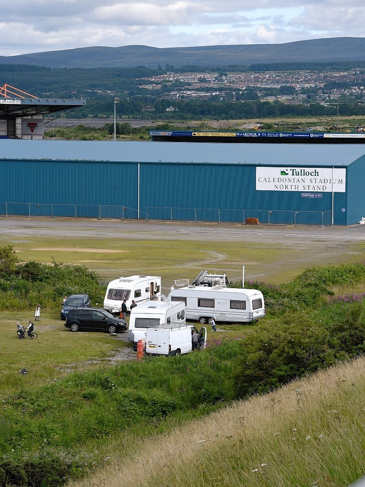 Travellers have made camp in the car park of the Caledonian Stadium in Inverness.