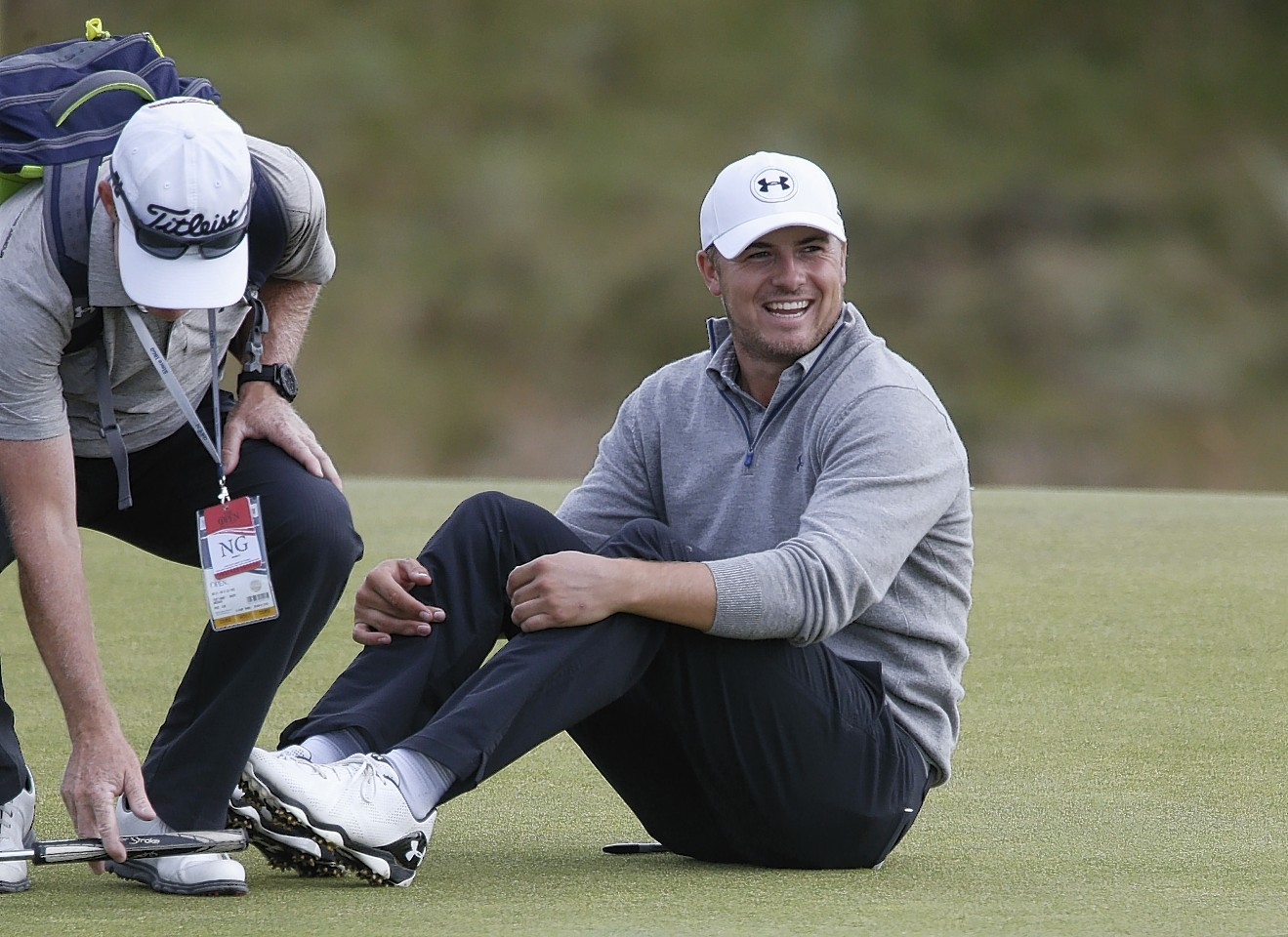 Jordan Spieth misses a putt but manages to see the funny side as he collapses to the ground