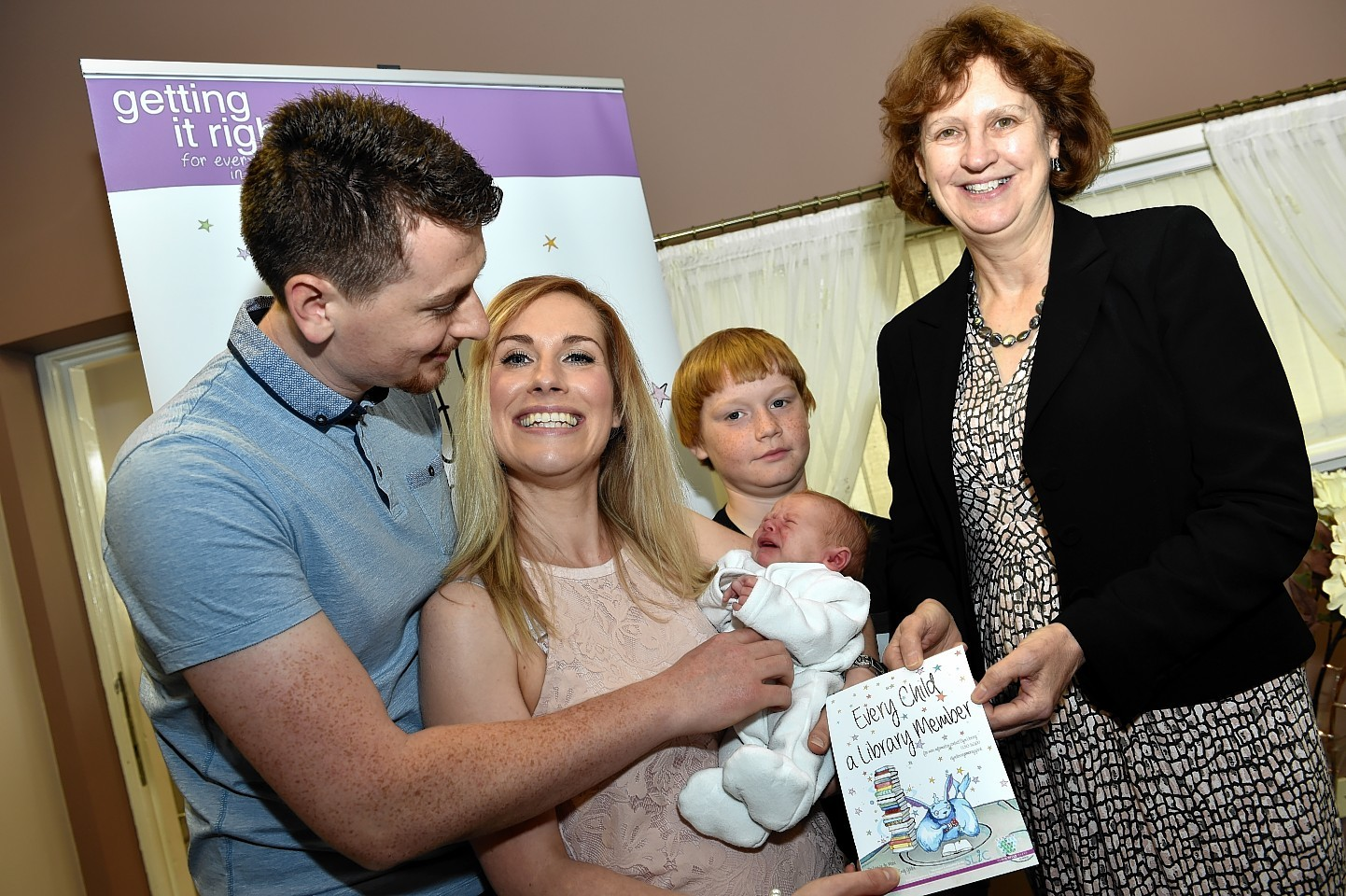 Paul Mitchell, Kathryn Mitchell, and elder son, Jake Mitchell with her baby son Lochlan and Cllr. Anne Skene