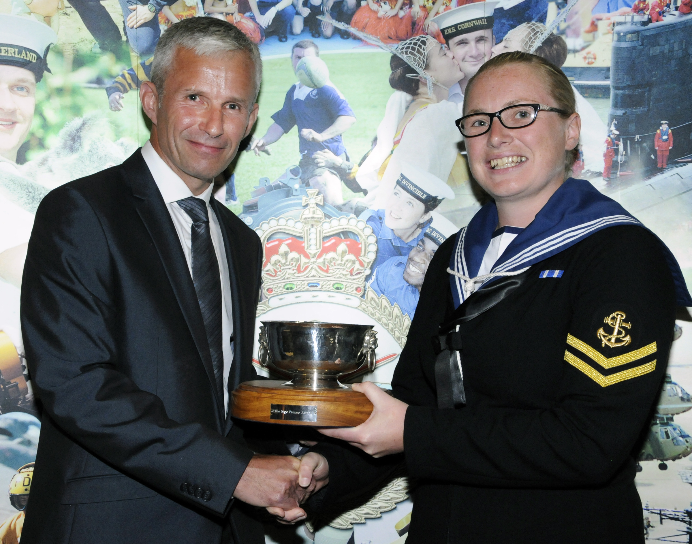 Lynsey Hay (right) receiving the The Nigel Prouse Award from Ritchie Killick.