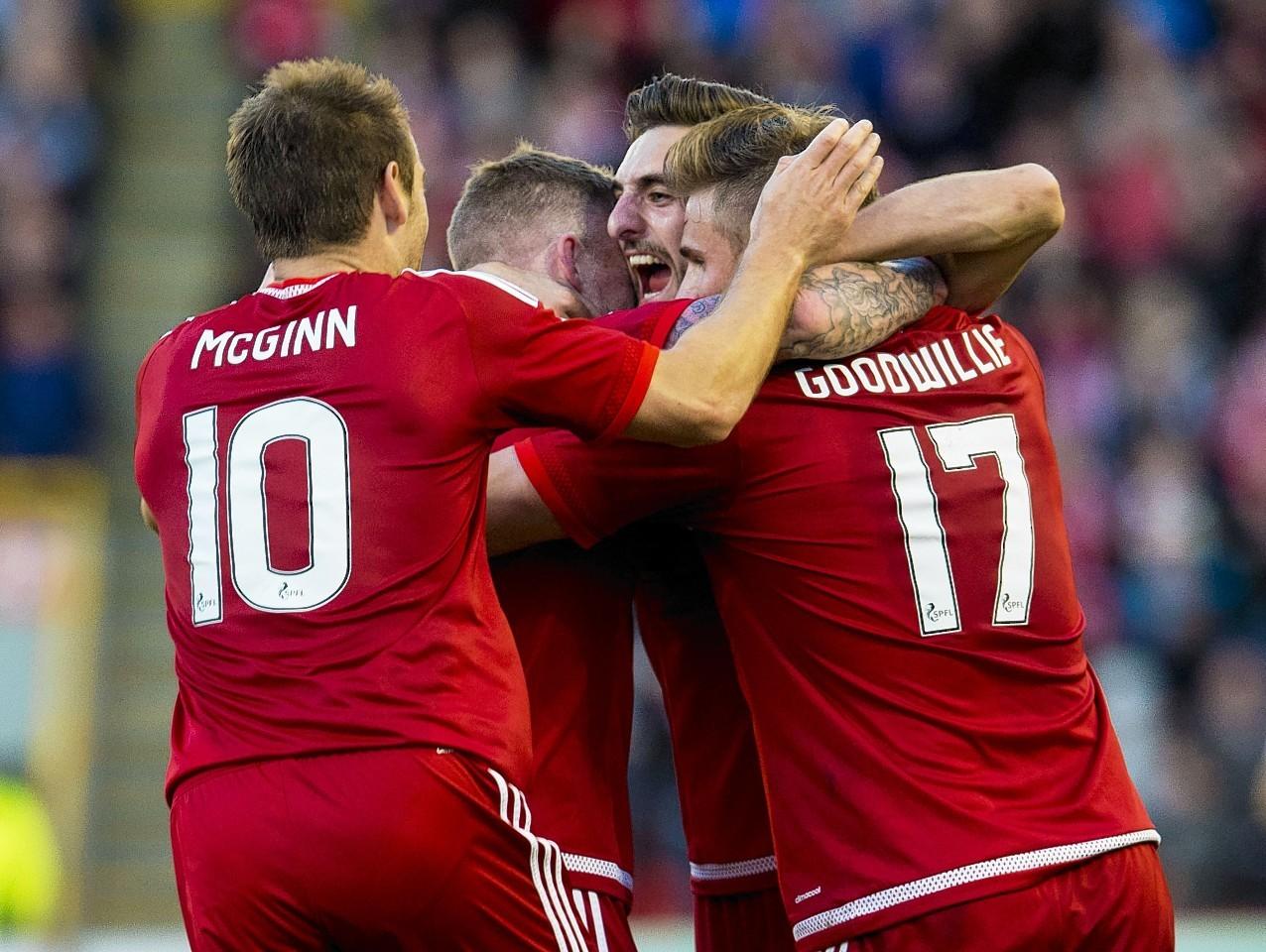 The Dons celebrate Jonny Hayes' goal against Rijeka