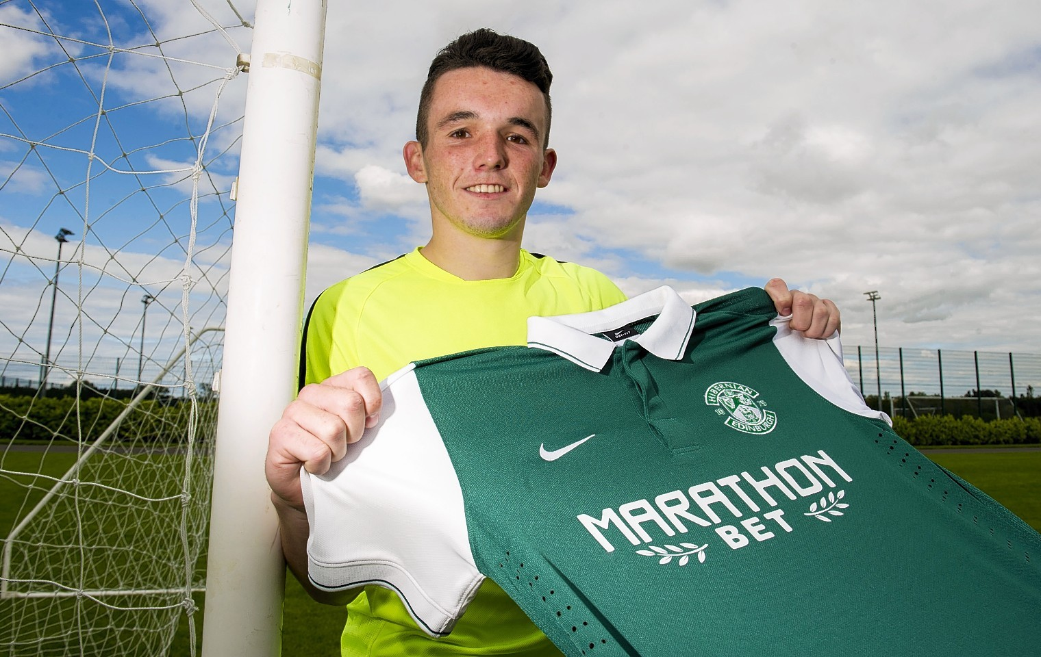 John McGinn has completed his move to Hibs after leaving St Mirren