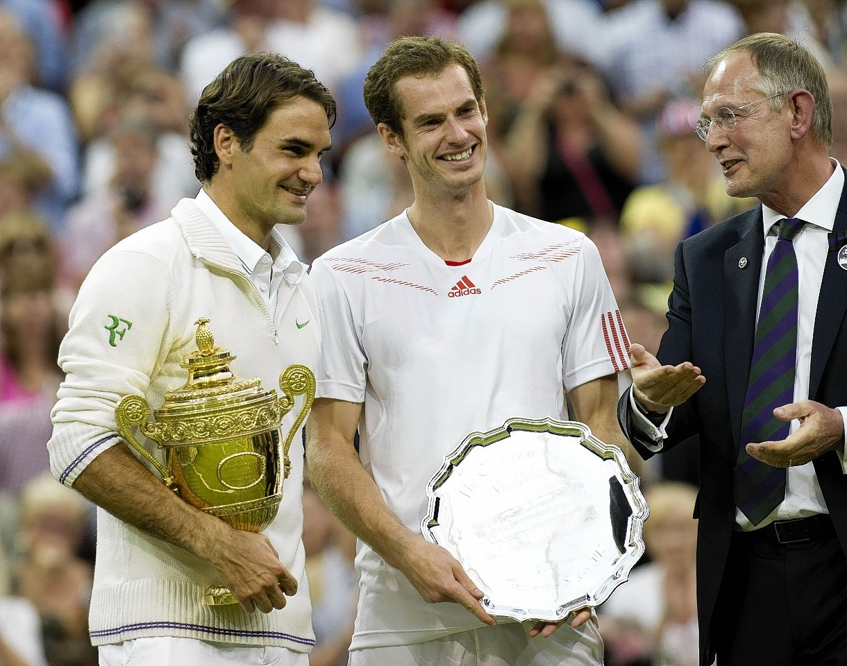 Murray puts on a brave face after he was beaten by Federer in the 2012 final