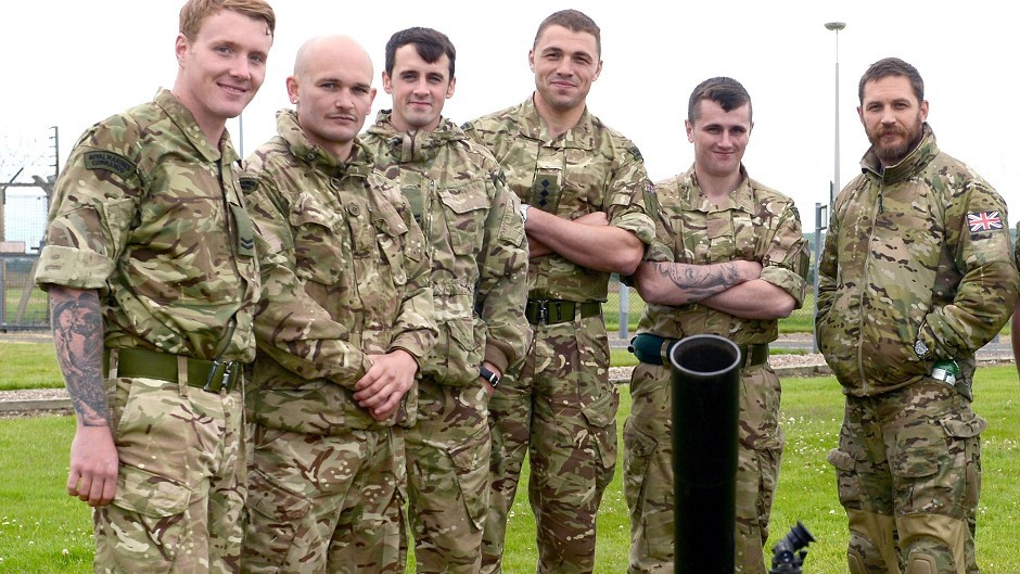 Actor Tom Hardy, right, during a visit to RM Condor in Arbroath, Scotland (LA Phot Pepe Hogan/MoD/Crown Copyright/PA)