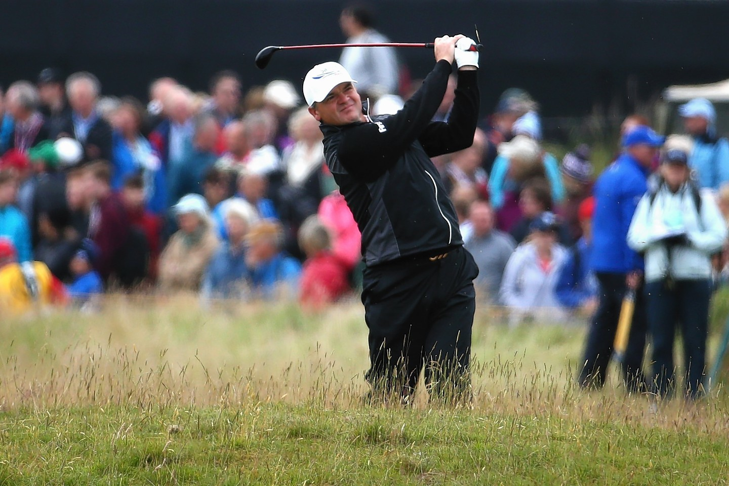 Paul Lawrie of Scotland plays his second shot on the 4th hole during the first round of the 144th Open Championship at The Old Course