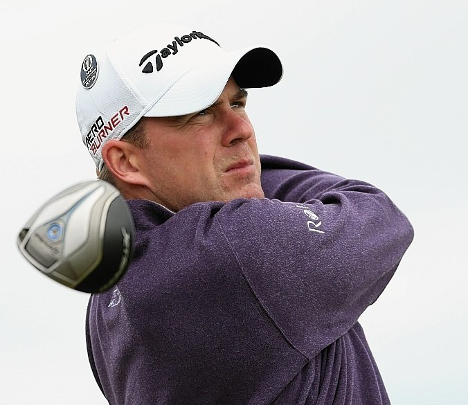 Richie Ramsay of Scotland tees off on 13 during a practice round ahead of the 144th Open Championship at The Old Course