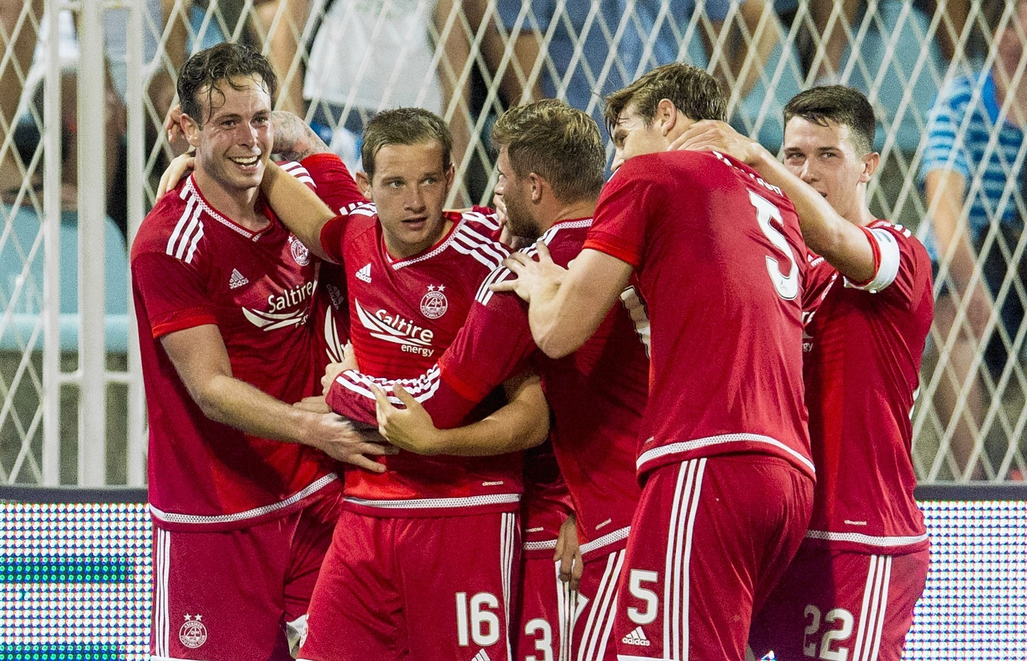 Andy Considine (left) celebrates after putting the Dons 1-0 ahead against Rejika