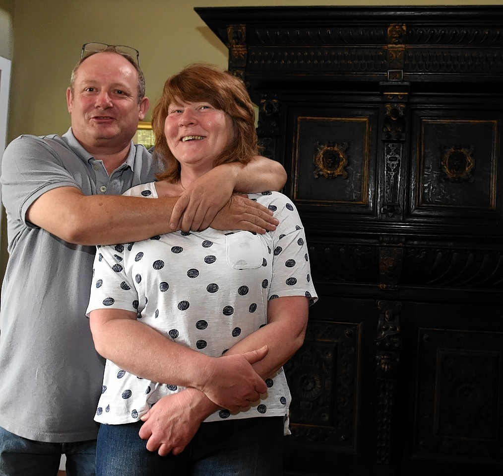 Ian Greig and partner Helen Davidson, Banchory with his cupboard ready for the Antiques Roadshow.  Picture by Jim Irvine