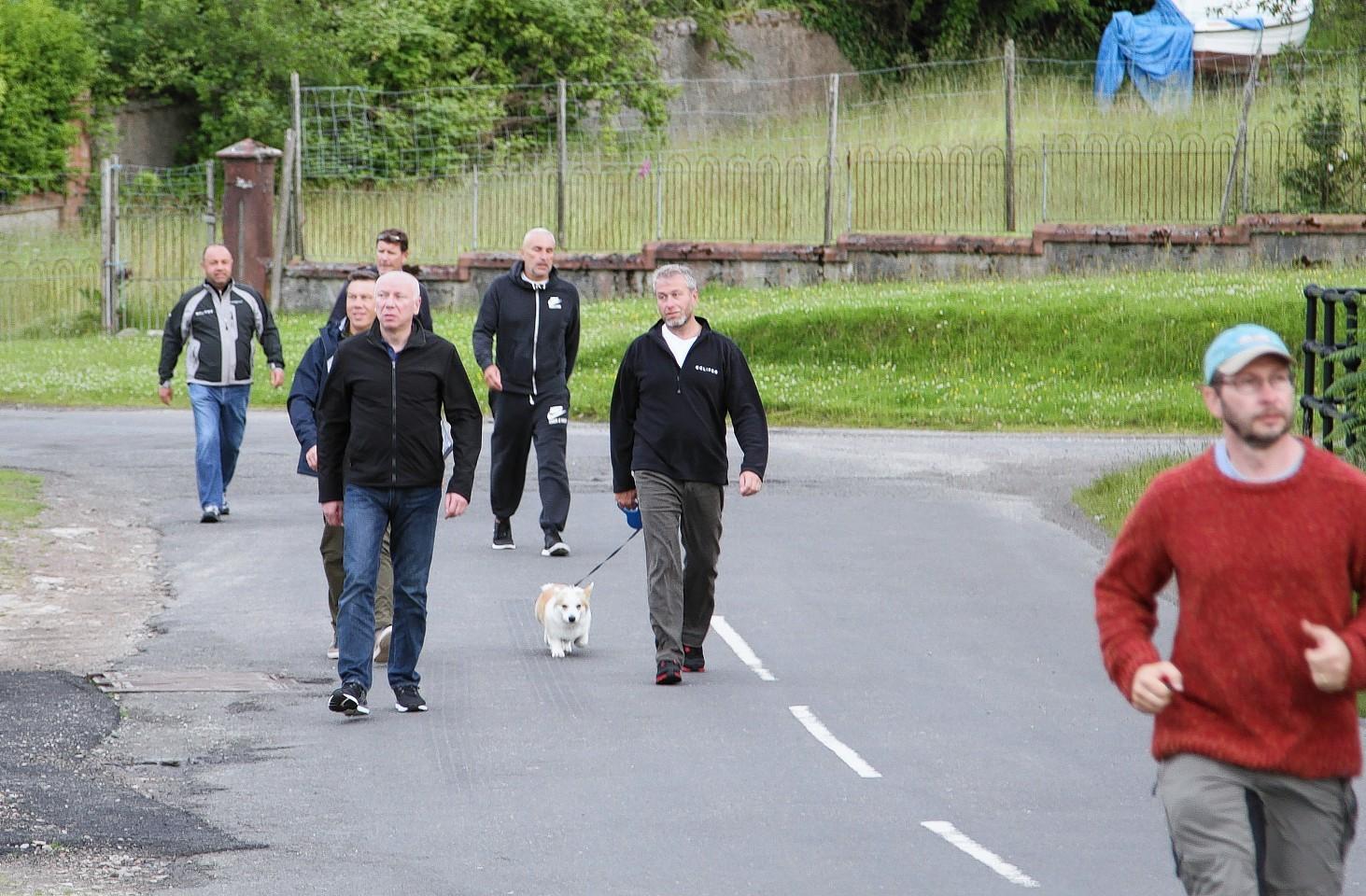 Abramovich and his corgi go for a walk around Arran